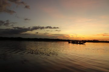 Laguna Grande and boat at sunset