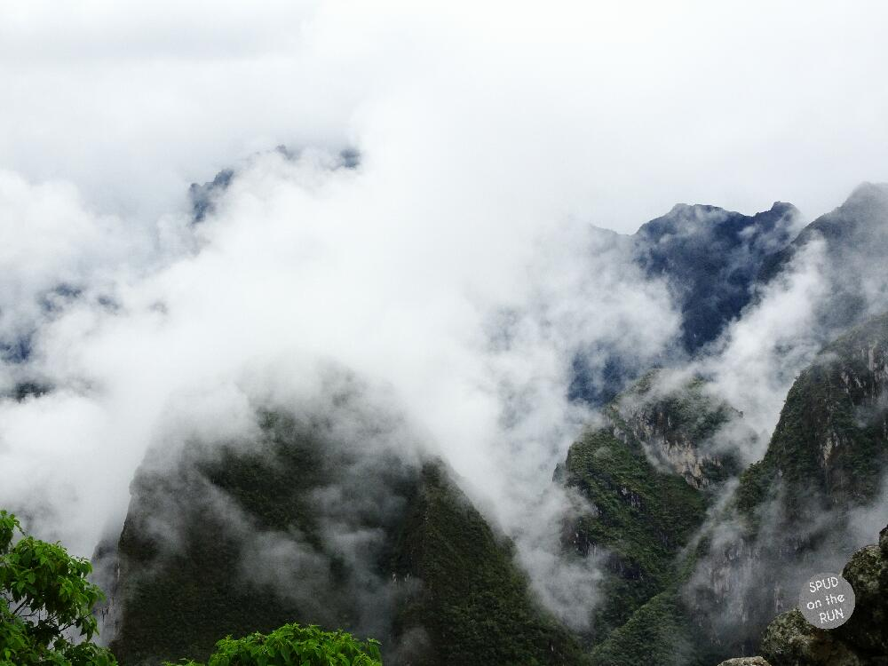 Machu Picchu mountins and clearing clouds